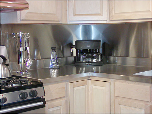 Attractive Stainless Steel Countertops And Wall Panels For The Kitchen Photo ©Dennis  Johnson